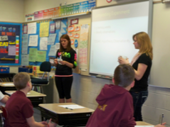 Springfield YES! students teaching ? graders about vermicomposting